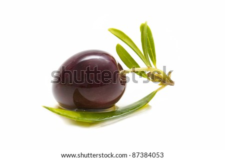 macro of a fresh olives bathed in olive oil - stock photo