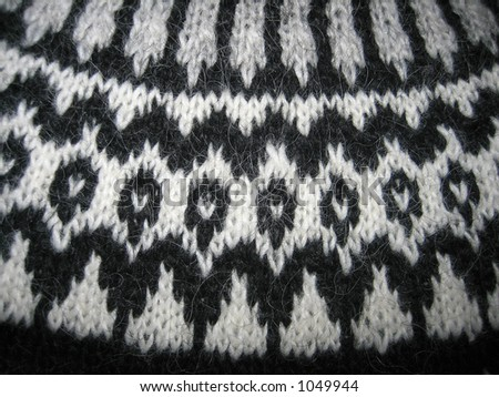 Macro of a handmade wool sweater with old pattern - stock photo