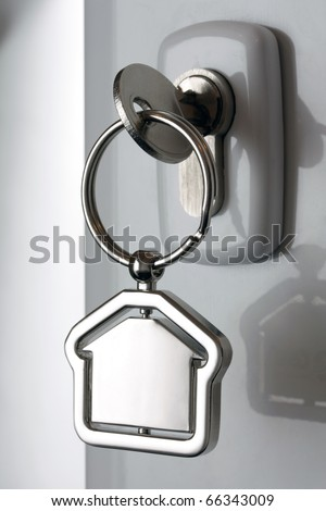 Macro of a key in a lock - stock photo