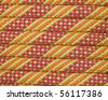 macro of a new orange yellow and red climbing rope - stock photo