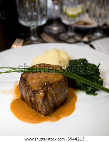 Macro of a professionally prepared gourmet Filet Mignon served as the main course of a reception