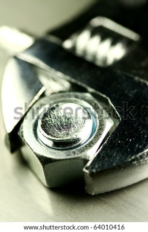 macro of a wrench on a bolt - stock photo