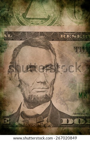 Macro of Abraham Lincoln on five USA one dollar banknote grunge vintage style - stock photo