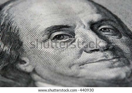macro of an american 100 dollar bill with benjamin franklin - stock photo