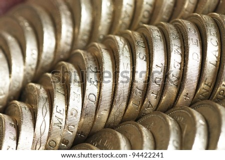Macro of british one pound coins arranged diagonally in rows