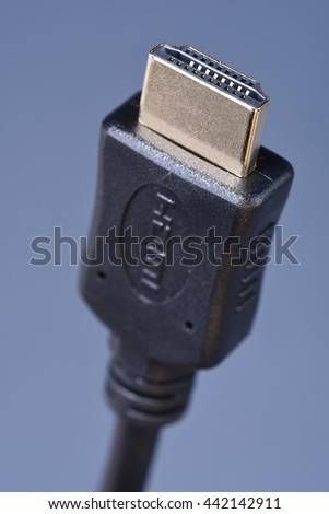 Macro of cable standard HDMI with selective focus on blue background