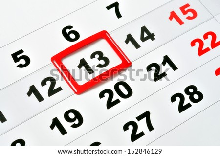 Macro of calendar showing friday the 13th - stock photo