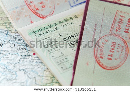 Macro of Chinese visa in passport - stock photo