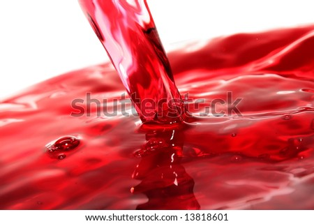 Macro of clear red juice pouring - stock photo