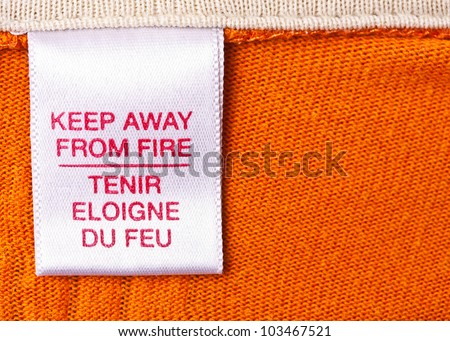 macro of clothing label whit text - stock photo