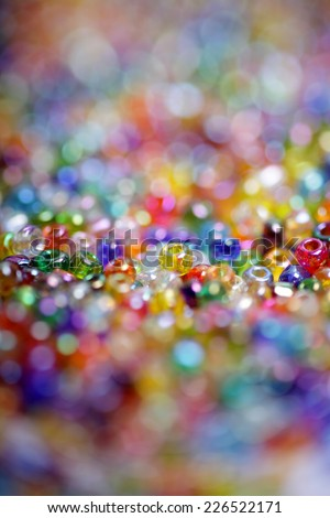 Macro of colorful beads with beautiful back- and foreground blur of colorful circles - stock photo