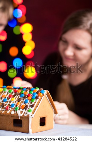 Macro of decorated gingerbread house on Christmas eve - stock photo