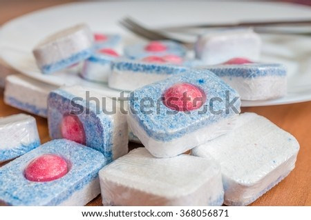 Macro of dishwasher tablets. Detergent for cleaning kitchenware.