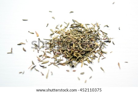 Macro of dried thyme leaves off the sprig - stock photo