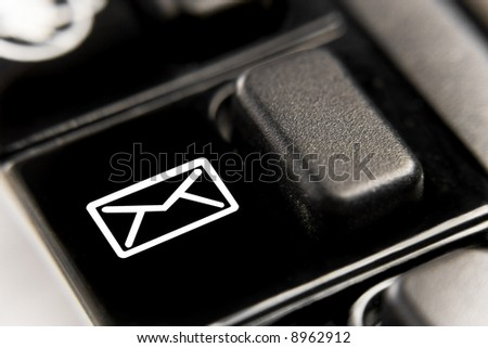 Macro of email key on black keyboard, very shallow depth of field - stock photo