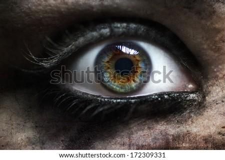 Macro of evil zombie eye female - stock photo