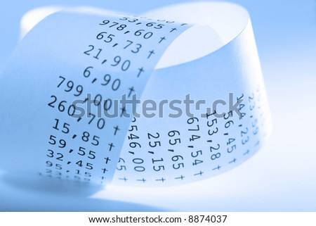 Macro of folded receit paper. Shallow DOF. Blue tone. - stock photo