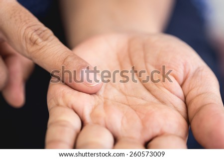 Macro of forefinger on left hand - stock photo