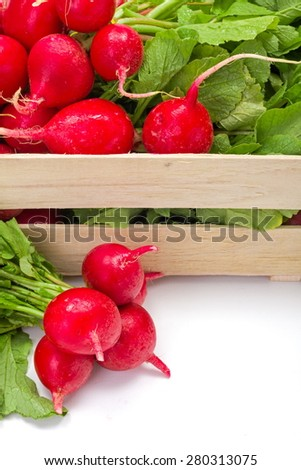 Macro of fresh red radish vegetable in wooden crate - stock photo
