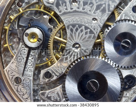 Macro of gears and works of antique pocket watch - stock photo