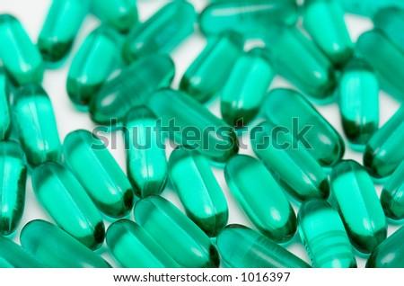 Macro of green gel pills - stock photo