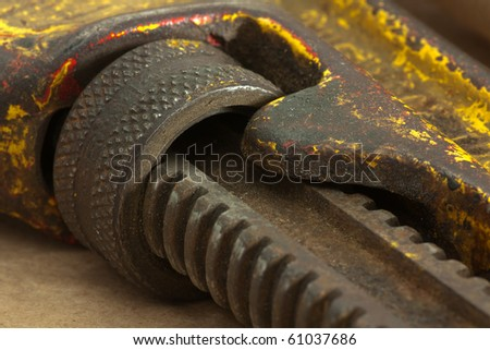 Macro of Grunge Pipe Wrench Adjustment Wheel + Gear. Shallow DOF. - stock photo