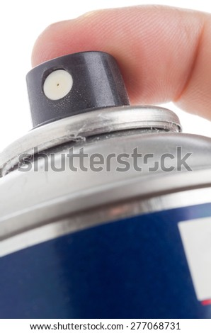 Macro of hand holding used spray can isolated on white background - selective focus on the nozzle - stock photo