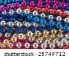 macro of Mardi Gras beads - stock photo