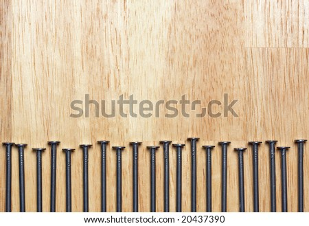 Macro of Nails on a Wood Background.