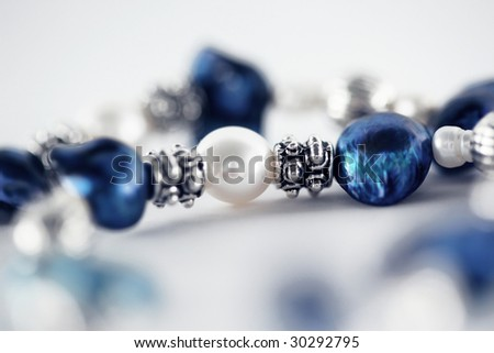 Macro of necklace blue and white - stock photo