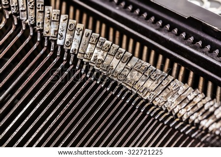 Macro of old typewriter letters on type bar