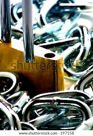 macro of open lock and chain.