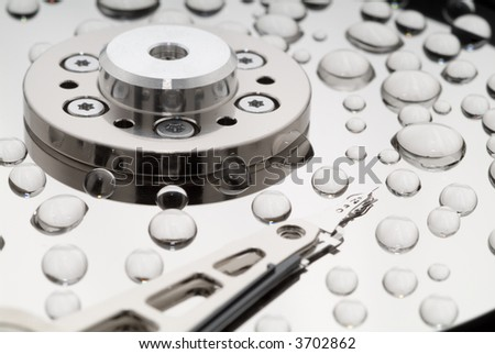 Macro of Opened Hard Disk Drive - stock photo