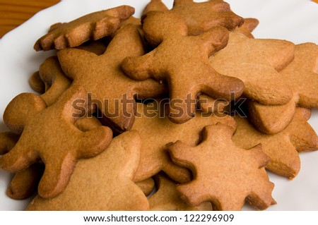 macro of plate with baked gingersnaps - stock photo