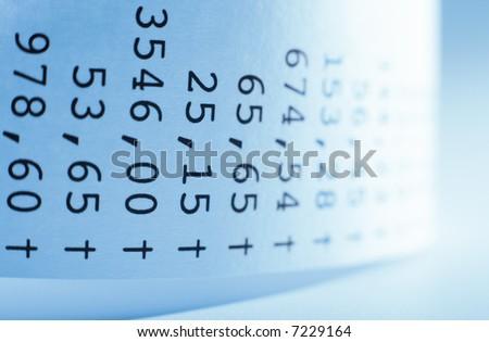 Macro of receit paper. Shallow DOF. Blue tone. - stock photo