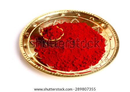 Macro of red gulal ( kumkum) Indian traditional powder. - stock photo