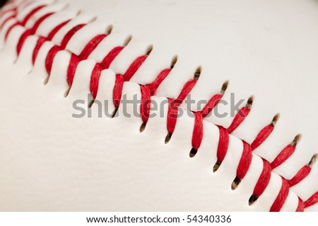 Macro of red stitches on the seam of a white leather baseball - stock photo