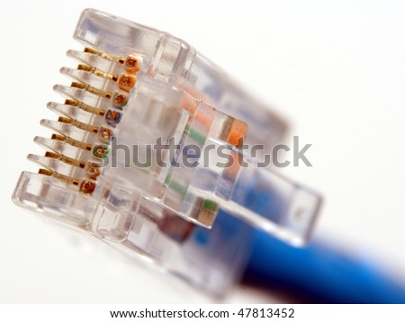 Macro of RJ45 network plug, showing the golden contacts, with blue network cable. - stock photo