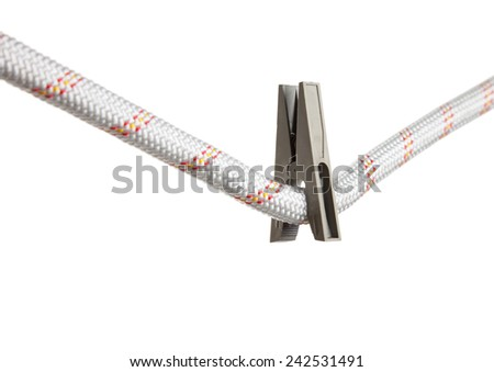 Macro of rough safety rope and clothes peg isolated on white, security concept  - stock photo