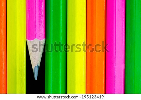 macro of rows of neon colored pencils  - stock photo
