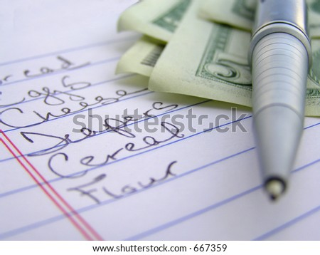 macro of shopping list money and pen - stock photo