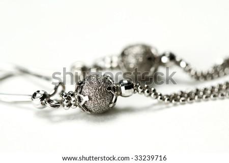 macro of silver earrings - stock photo