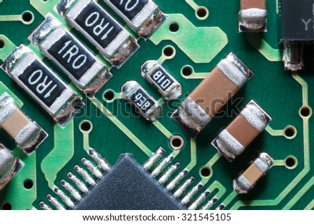 Macro of SMD circuit board: resistors and condensers - stock photo
