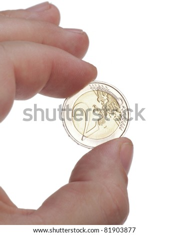 Macro of someone holding one euro coin