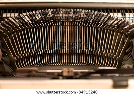 Macro of standard typebars on old typewriter - stock photo