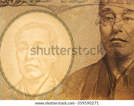Macro of Ten thousands japanese yen bills on white background, watermark is visible on backlit.