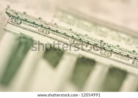 Macro of the back of the U.S. Five Dollar Bill showing small State Names as anti-counterfeit measure. - stock photo
