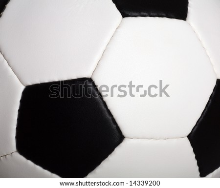 Macro of traditional Soccer Football black and white - stock photo