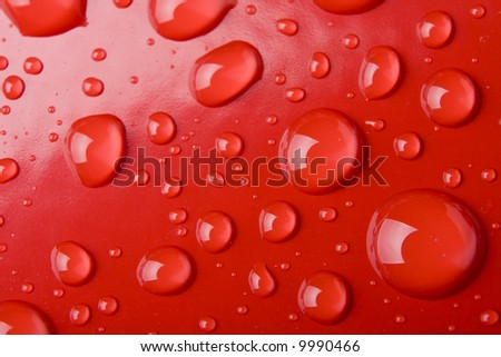 Macro of Water drops on a red surface - stock photo