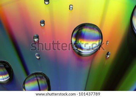 Macro of water drops on multicolor background - stock photo